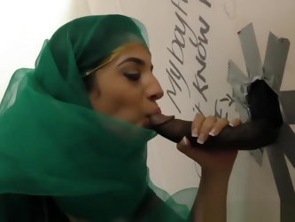 Pretty Pakistani babe visits the gloryhole for black cock