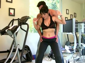 She is here to work out to keep her body in shape. So she is assisted by handsome coach. He seduces her touching her body sensually. She gets the hint