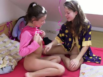 After hand stroking each other's cuddly bodies and kissing gently, two mesmerizing fresh faced amateurs put on princess costumes for a fun play.