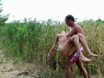 Tasty looking blond amateur takes sunbath after swimming in the pond while a horny dude approaches her to give her erotic massage in steamy sex clip b