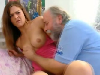 Amateur redhead chick Alyona is playing dirty games with an old fart in the bedroom. She lets the guy lick her boobs, then spreads her legs wide and w