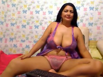 A hot brunette mom gave me a nice private webcam show. She was wearing panties and cami and I couldn't take my eyes off her cleavage.