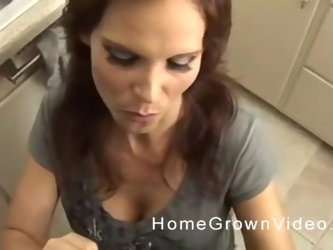 Amateur brunette MILF gets down on her knees to blow cock