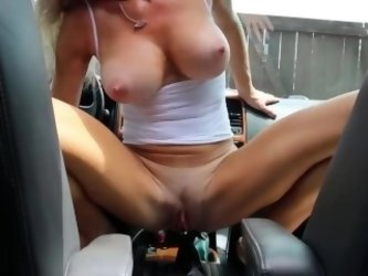 Milf with incredible body fucks her car shifter in public