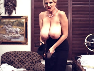 Kelly Madison enjoys taking off her clothes and showing off her tits