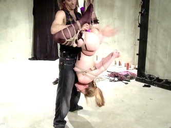 Submissive blonde hogtied, hanged upside down and forced to an orgasm