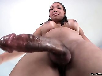 This black bodied vixen Vanilla has a new long African cock. She has wonderful big tasty boobs with cool round black nipples. But huge cock makes her