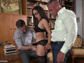 Nerdy brunette babe Ginebra Bellucci takes two cocks in a library