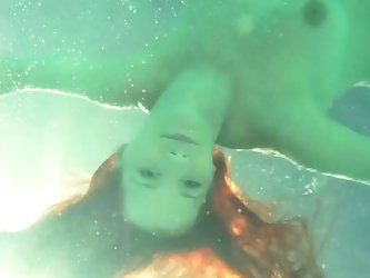 Underwater posing by busty Ariel