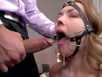 Handcuffed girl Kandall N in barely there mini dress wears a special mask and keeps her mouth wide open all the time against her will. She gets throat