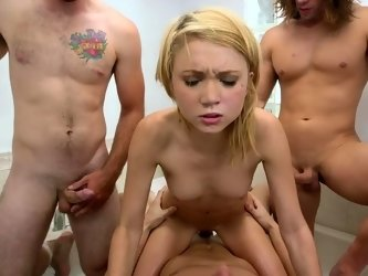 Three huge dicks are sharing one petite young cunt for group fuck