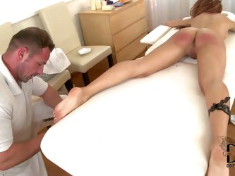 Fully nude babe Leyla Black with long legs and shapely ass gets tied to massage table. Man in white explores her helpless body with enthusiasm. He spa