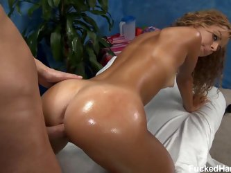Teenage chick Jessie with wet bubble butt is irresistibly sexy. She's naked on massage table. Masseur can't miss his chance to give her puss