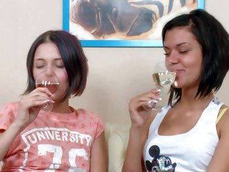 Margaret and Varvara drink champagne before having lesbian sex. Young lesbian girls get drunk and then get their girl on girl fuck session started,
