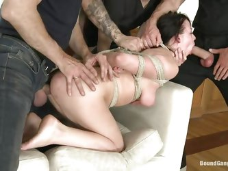 Judit is a slut and the guys want to show us that. The tied her up and fucked her pretty mouth on at a time before putting her on the couch and fuckin
