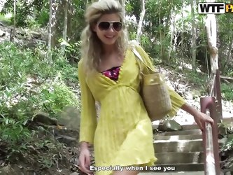 This cute blonde chick is ready to do some exploring. She heads down the hiking path and arrives at a nice river. Her guide is checking out her long s