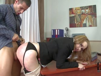 Four-eyed elegant secretary bends over for her boss. She gets her asshole stretches with fingers before he sticks his boner in her anal tunnel from be