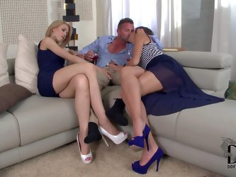 Turned on blonde and brunette sluts with long sexy legs in high heels and provocative dresses seduce handsome stud and fight over his stiff meaty knob