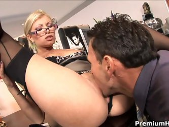 Long legged glassed office blonde Donna Bell in black nylons and high heels gets her hot pussy eaten and fucked on the desk by horny boss. This four-e