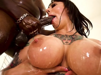 The point of this interracial blowjob is to be as sloppy as possible and Dollie Darko definitely knows how to make a mess. Her face and tits end up co
