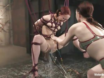 Sabrina Sparx, a young red head is tied up and is getting punished for cheating on her girlfriend. She is punished hard with her hands and legs tied u