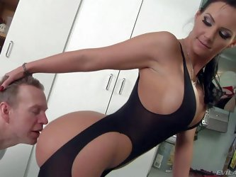 Phoenix Marie in tight crotchless body suit has perfect body. Hot blooded brunette with big boobs and absolutely gorgeous big round ass smothers a man