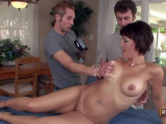 Hot bodied slim milf Kayla Synz with big boobs, long legs and shaved pussy gets naked in front of two guys for massage. But she gets a fuck instead of