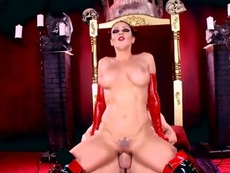 A sexy devil girl with huge tits is sitting on a big cock