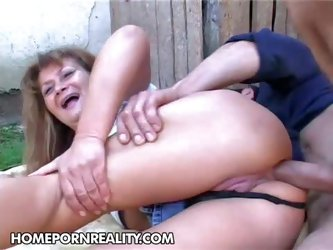 Aged slut Samantha gets her fat ass fucked deep and hard by her young sex partner outdoors without taking off her thong panties. Watch aged whore enjo