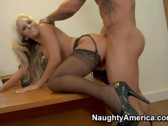 Amazing long haired blonde secretary Brandy Blair with steaming hot body and pretty face in garter belt and high heels gets fucked hard on desk by her