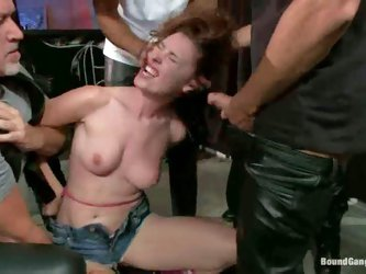Melody Jordan is a cute girl that gets treated like a fuck toy by crazy men. She gets gangbanged in a biker's bar. They bare her tits and pull ou