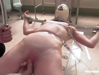 Madison Young is a pain slut with smooth pink pussy and small tits. Helpless lady in latex mask gets tortured by crazy doctor Mark Davis who can'