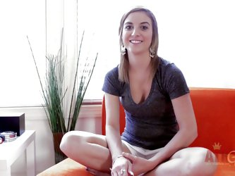 Cute brown haired model Katie King in t-shirt and panties gives behind-the-scenes interview with smile on her lovely face. She's a charming young