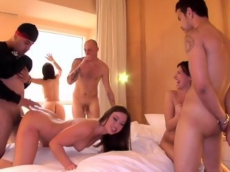 Three girls are having group sex with three guys in the hotel room