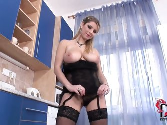 Katarina packs her immense knockers into tight black corset and then pulls it out