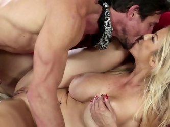 A mature blonde with a nice ass is getting a dick in her mouth