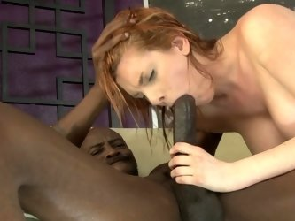 A redhead spreads her tight pussy so she could be penetrated