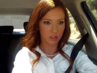 Lily Labeau is a pretty lady in white blouse and skirt. She has fun playing with her snatch right in her car. She pulls her panties aside to finger he