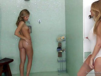 Lesbian milf Julia Ann joins sexy naked teem Chastity Lynn in the shower. They are wet and sexy making love under the shower. Julia Ann loves Chastity