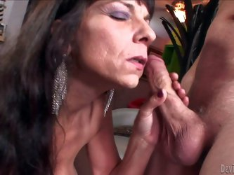 Sage Hughes is s dick hungry mature brunette with hot body. Topless well-endowed aged woman with huge fake tits takes hard young dick in her mouth. Sh