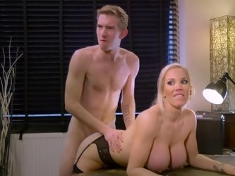 A blonde pushes her tits together for a tit fuck in the video