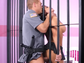 Impressive hottie with big round breasts flashes them while talking to her layer. Young prison guard gets hypnotized by her shapes and really wants to