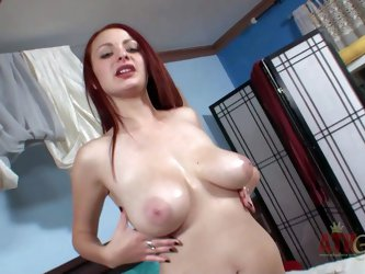 Jessica Robbin is a naughty redhead with big natural breasts. Shameless girl strips down to her birthday suit in the bedroom then shows off her big me