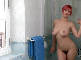 Vanessa is a curvy Polish babe with great big boobs. She takes off her cotton panties and displays her hairy snatch before taking a shower. Hot bodied