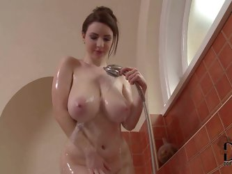 Turned on nude brunette Karina Heart with gigantic jaw dropping natural knockers and soft milky skin enjoys teasing under warm shower in awesome breas