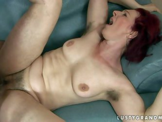 Debra is a fuck hungry red-haired mature woman with bushy pussy and hairy armpits. She gets her muff fucked hard by thick dicked boy. She takes his yo