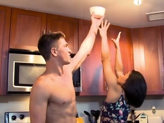 Handsome dude helps his lady in the kitchen with his meat pole