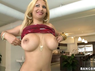 Busty cuban blonde Paris Sweet bares her big melons and strips out of her skin tight jeans. She is proud of her round latin ass and huge tits. She str