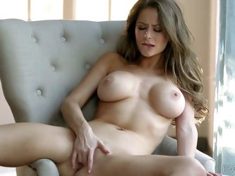 Emily Addison with long brown hair and huge tits poses naked before masturbating. She opens her gorgeous long long legs wide and stick fingers in her