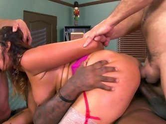 A big ass woman with large tits is getting her ass rammed deeply